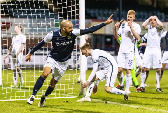 Dundee's Liam Fontaine celebrates after making it 2-1 against Alloa.