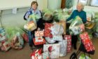 Betty Mathieson (left) and Liz Howson at St Andrews Church Hall in Brechin with some of the angel tree appeal gifts.
