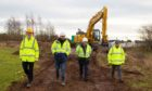 Steven Reid SSE Renewables;, Scott McCreadie, project manager Nexans; Angus Council leader Councillor David Fairweather; Maurice Dee, one of the workers on the cable installation team from contractor, Roadbridge.
