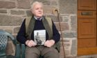Kirriemuir Landward East community council chairman Ivan Laird with the book of poems.