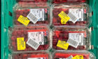 GREEN DEAL: Raspberries reduced in price in a shop to avoid food going to waste.