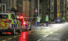 Police at the scene of the Lochee Road crash.