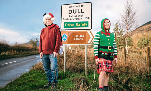 Tommy Pringle with his son, Jamie Pringle, beside the sign of Dull, their hometown near Aberfeldy.