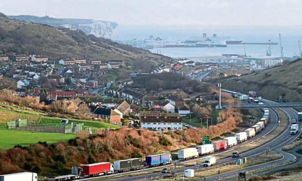 Lorries queue for The Port of Dover along the A20 in Kent as the Dover TAP (Traffic Access Protocol) is implemented due to high volumes of freight traffic.