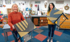 Sarah and Gayle with their upcycled tables.