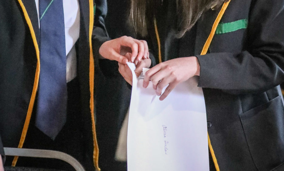 Pupils receiving exam results.