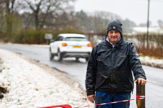 Farmer Andrew Wilson is urging councillor to push for the stretch of A916 to be made safer.