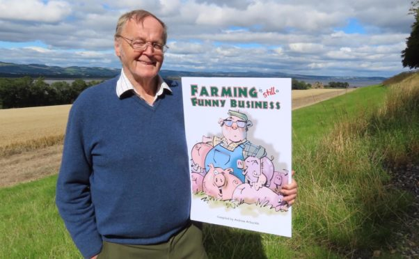 Andrew Arbuckle with the cover of his new charity book, which is raising funds for RSABI.