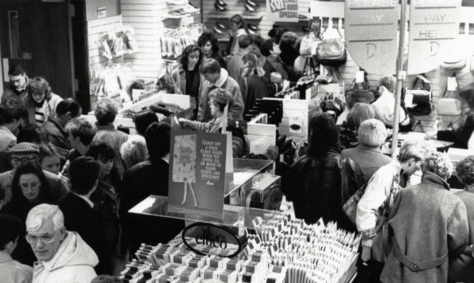 A busy scene from a Boxing Day sale in 1989.