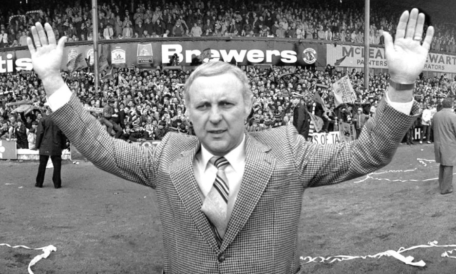 Jim McLean celebrates after Dundee United win league title.