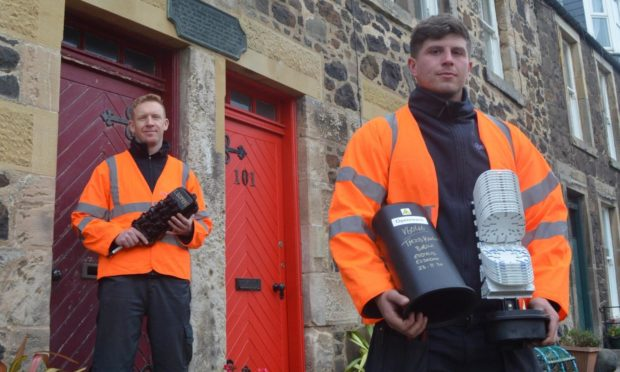 Openreach engineers, left, Elliot Kane and Jad Douglas in Lower Largo with the new fibre broadband technology.