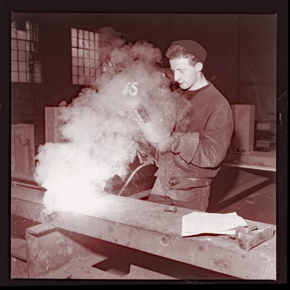 Jimmy Johnstone at his welding job (1962).