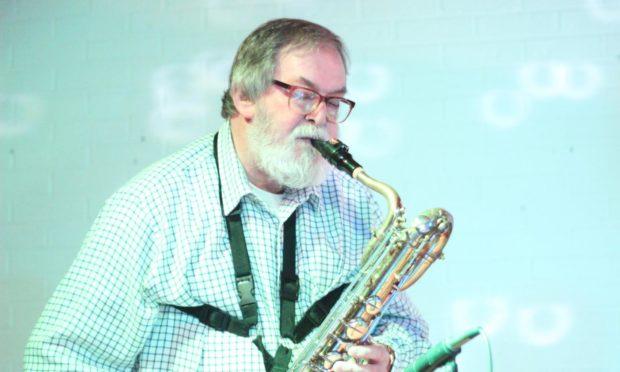 Jim Morrice playing his beloved saxophone