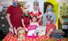 Darren Gracey, Cameron Gracey (13), Jett Young (8), Mrs Claus - Jennifer Donachy and Pamela Luscombe.