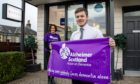Harrison Whyte of Whytes of Monifieth and Rosemary Moncur of Alzheimer Scotland.