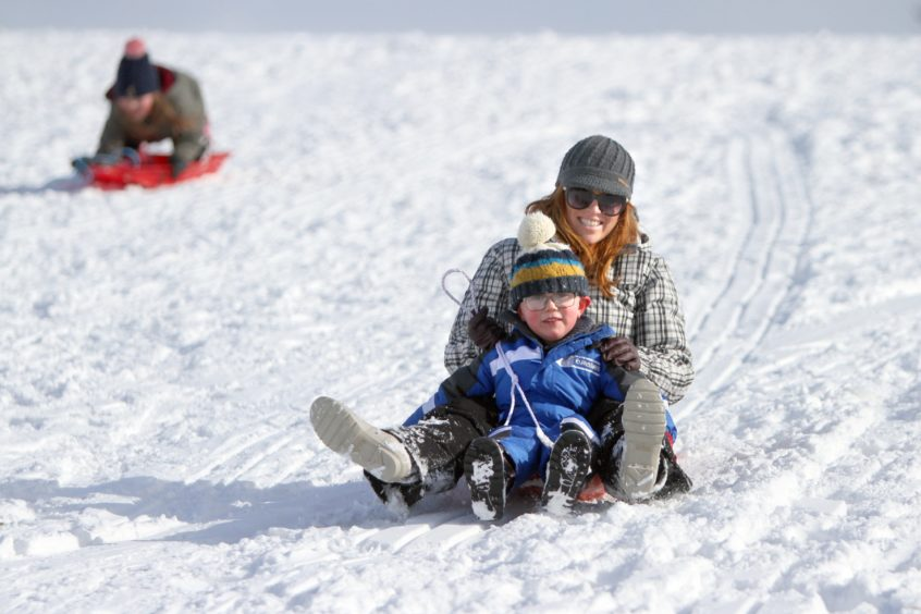 Susan and Sam Trueland sledging near Balmossie Road. Thursday on March 1 2018.