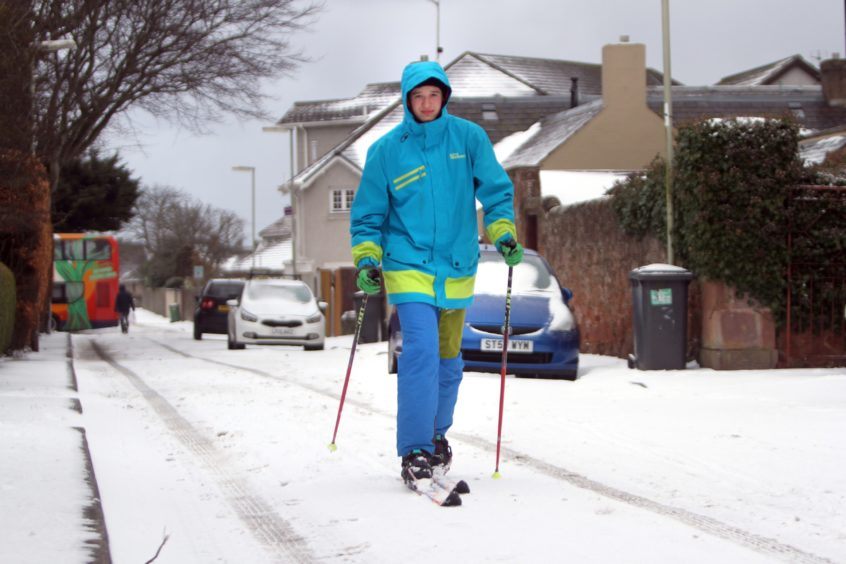 Angus Sangster uses telemark skis to get around the streets of Carnoustie during the snow storms in March, 2018.