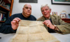 Historian Lenny Low and Jamie Lindsay with the sasine document from 1593 relating to Jamies family