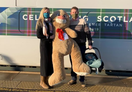 Dr Emily Barker, Major Tim Barker and their 10-week-old daughter Thea with Evelyn's bear.