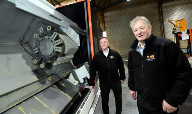 Kincardine Manufacturing Services Ltd, have taken delivery of a CNC machine from Japan. Sales manager Grant Adams and director Graham Truscott.