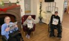 Elder Lea Manor residents with their copies of The Courier.
