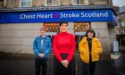 Manager Sandra Kerr, alongside Perth Academy volunteers Brooke Sailor (right) and Nathan Hunter (left) outside Chest Heart and Stroke Scotland in Perth