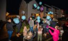 Balloons being released for the birthday of Keiran Lamond.