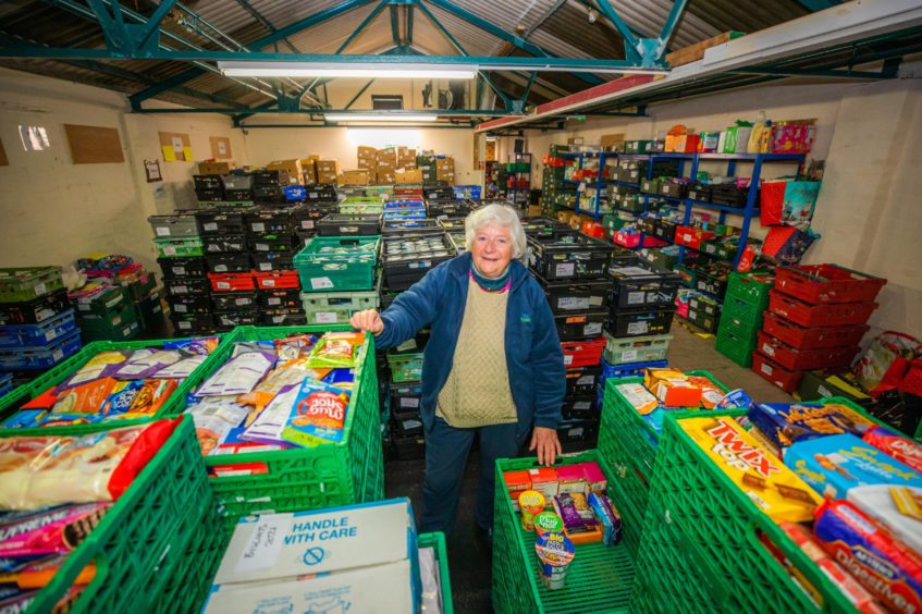 Marjorie pictured amongst the donations of food.