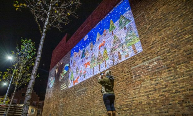 Kids Christmas cards projected on Mill Street, Perth