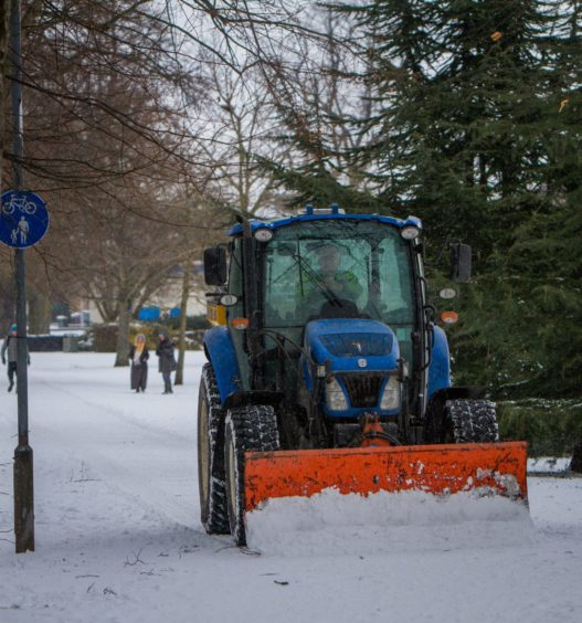 A tractor clearing paths on the South Inch, Perth on Wednesday, February 28 2018.