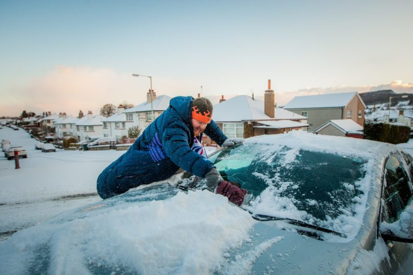 Richard Gray clearing his car for work. Glenlyon Road, Perth in February 2018.