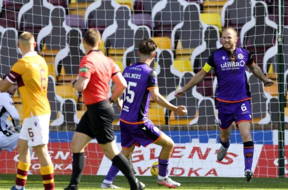 Mark Reynolds, right, after scoring against Motherwell.