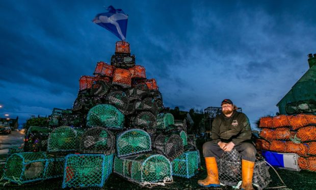 Fife fisherman, Finlay Innes has created a huge Christmas tree made out of more than 150 creel baskets at his home in St Monans.
