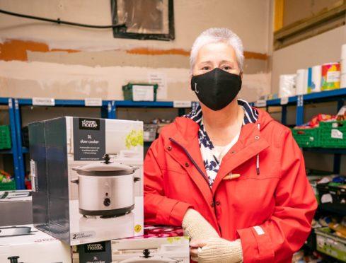 Linda Millar dropped off dozens of slow cookers at Perth Foodbank last week.