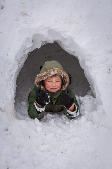 Tyler Bray (7) in an igloo having the time of his life in Glenrothes on Friday, March 2 2018