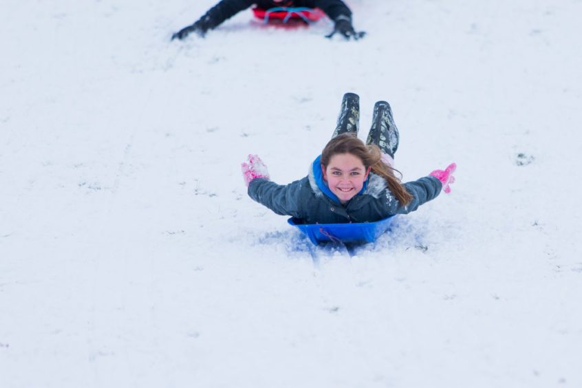 Sledging at Riverside Park, Glenrothes. Natasha Turnbull (11) enjoying the snow in February 2018.
