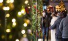 Shoppers pass Christmas light displays.