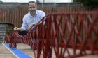 Michael Dineen with his Lego bridge.