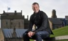 Author Neil Forsyth next to Broughty Castle.