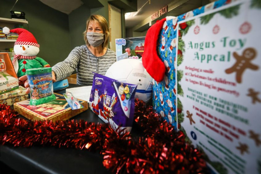Sharon Spink prepares a parcel for a child at Christmas.
