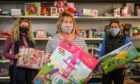 ANGUS TOY APPEAL: Sharon Spink (centre) with volunteers at the Arbroath-based charity.