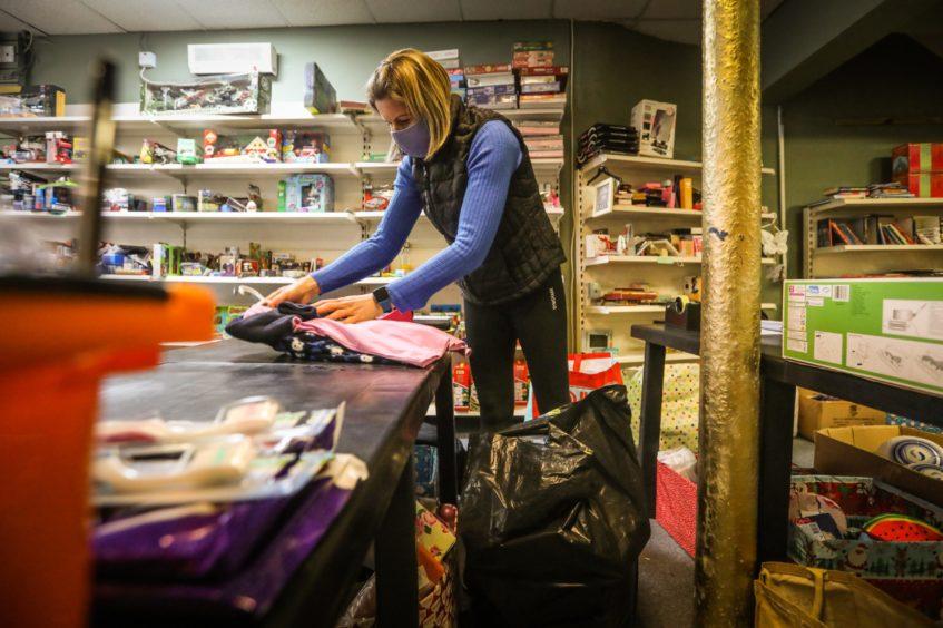 Volunteer Jillian McGregor prepares a parcel.