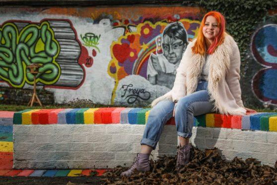 Brooke Reid at a mural of Freya.