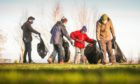 Volunteers carrying out a covid-safe litter pick