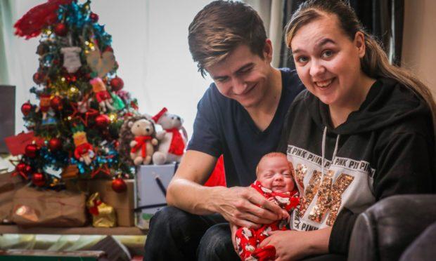 Baby Lewis, 10 weeks, with mum Bella and dad Lewis.