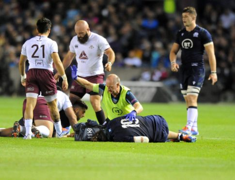 Ben Toolis gets treatment for a head knock playing for Scotland against Georgia last year.