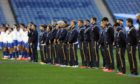 The players line up for the anthems at an empty Murrayfield before Scotland play France in the Autumn Nations Cup.
