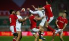 "Flailing arms ""contesting"" another kick in the Wales-England Autumn Nations Cup game."