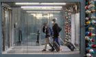 Travellers walk through O'Hare International Airport in Chicago on Thanksgiving weekend.