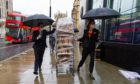 Staff from the Conrad Hotel in London deliver food to the teams taking part in the Brexit talks.